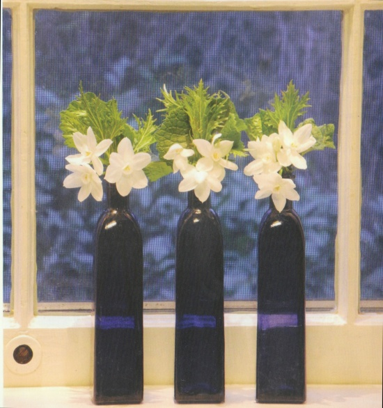 Blue bottles, white flowers