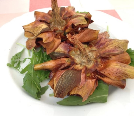 Deep fried artichoke on a plate