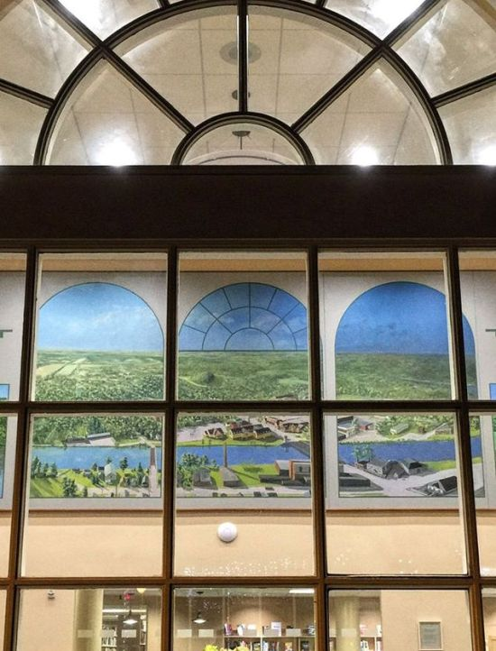 Library window with Erie Canal mural